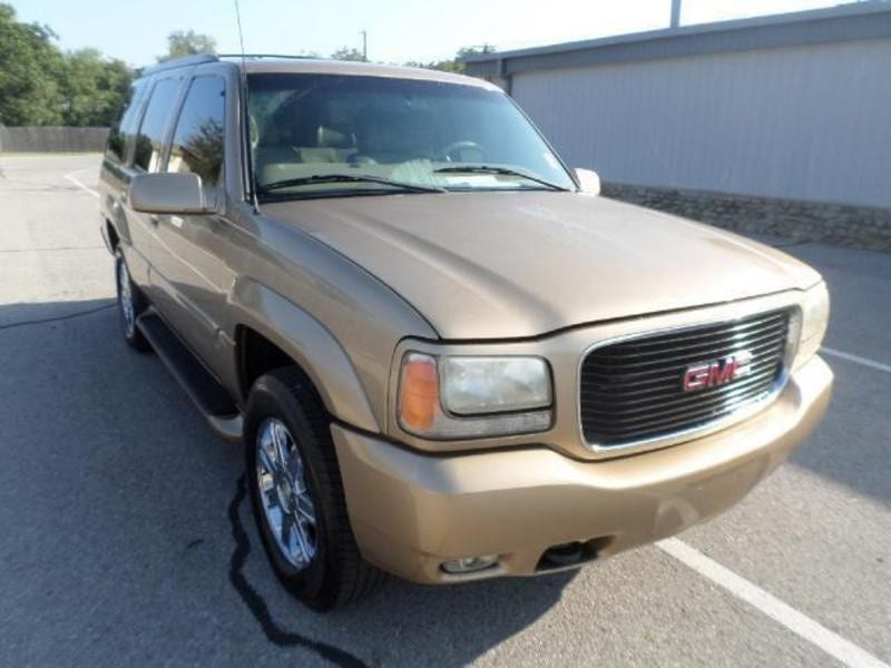 Gold GMC SUV