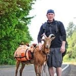 Man walking across country with goat stops at Gunpowder Lodge