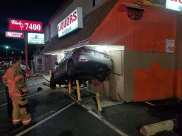 Vehicle crashes into Rosedale building